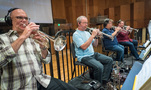 The trumpet section performs on <i>Ferdinand</i>