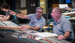 Composer John Powell discusses a cue with scoring mixer Shawn Murphy