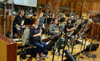 The woodwind section prepares to record the next cue