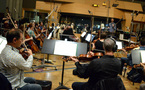 The orchestra records with composer/conductor Rob Simonsen