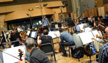 The orchestra makes edits to their parts