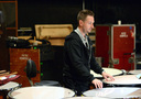 A percussionist tunes the timpani