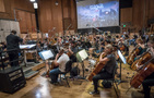 Carl Rydlund conducts the orchestra on <em>Halo Wars 2: Awakening the Nightmare</em>