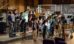 The children's choir records a cue for <i>The Healer</i>