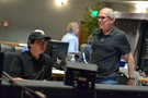 Composer Nathan Wang discusses a cue with scoring mixer Dennis Sands