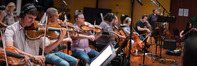 The orchestra performs on <i>Kevin (Probably) Saves the World</i>