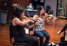 Two violinists perform