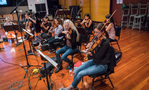 The strings record a cue for <i>Kevin (Probably) Saves the World</i>