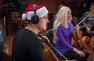 A festive cellist performs