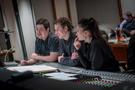 Daniel Chan, Nathan Blume and Sherri Chung listen to a cue