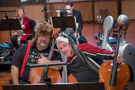 Cellists Armen Ksajikian and Steve Erdody came prepared for winter during this holiday session