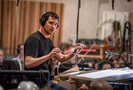 Composer Ramin Djawdi conducts his score to <em>The Mountain Between Us</em>
