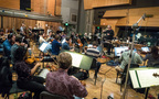Composer/conductor Bruce Broughton and the orchestra record a cue