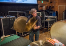 Percussionist Brian Kilgore plays the crash cymbals