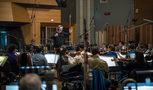 Composer/conductor Bruce Broughton and the orchestra perform