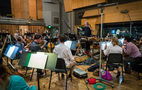 The orchestra records a cue with composer/conductor Bruce Broughton
