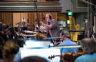Composer/conductor Joel McNeely and the orchestra perform