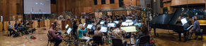 Composer Joel McNeely conducts the orchestra during a session for <i>The Orville</i>