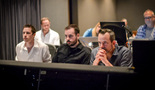 Additional music composers Zak McNeil and Phill Boucher watch the session with composer Geoff Zanelli
