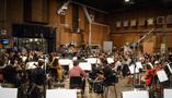 The orchestra records a cue with conductor Nick Glennie-Smith