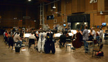 Conductor/orchestrator Tim Davies and the Hollywood Studio Symphony perform on <em>Rings</em>