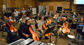 The enormous cello, viola and bass sections warm up