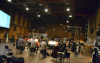 Conductor/orchestrator Tim Davies and the orchestra record a cue for <i>Rings</i>