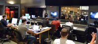 The booth watches as the orchestra records a cue from composer Matthew Margeson's (center, red) score for <i>Rings</i>