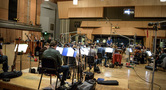 Conductor Pete Anthony and the orchestra make edits to a cue