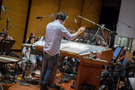Composer Jeff Russo conducts the orchestra