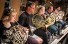 The French horn section performs on <i>The Tides of Fate</i>