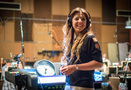 Composer Pinar Toprak talks with the booth