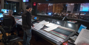 Composer Steve Jablonsky goes over the score at the console