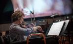 Concertmaster Belinda Broughton records a solo