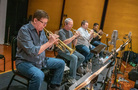 Wayne Bergeron, Jon Lewis, Rob Schaer, and Barry Perkins perform on trumpet