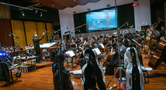 Conductor Nick Glennie-Smith and the Hollywood Studio Symphony perform on <em>Aquaman</em>