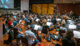 Conductor Nick Glennie-Smith and the Hollywood Studio Symphony record a cue