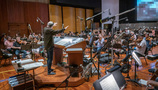 Conductor Nick Glennie-Smith performs a cue for <i>Aquaman</i> with the Hollywood Studio Symphony