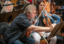 Concertmaster Bruce Dukov makes an edit to his part