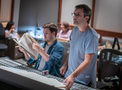 Composer Rupert Gregson-Williams watches the session as technical score engineer Forest Christenson looks over a cue