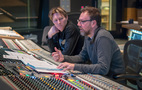 Scoring mixer Gustavo Borner (right) and composer Tyler Bates listen to a cue