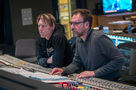 Composer Tyler Bates and scoring mixer Gustavo Borner listen to the orchestra performing on <em>Deadpool 2</em>