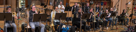 The brass section: Steve Suminski, Alex Iles, Nick Daley, Alan Kaplan, Steve Holtman, and Bill Reichenbach on trombone; Doug Tornquist and Ross De Roche on tuba; Dan Rosenboom, Rob Schaer, Jon Lewis, Barry Perkins on trumpet