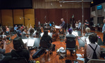 Co-composer Blake Neely conducts the Hollywood Studio Symphony on <em>Deception</em>