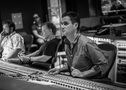 Scoring mixer Noah Snyder adjusts levels as composer Danny Elfman and additional music composer David Buckley listen