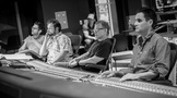 Orchestrator Philip Klein, additional music composer David Buckley, composer Danny Elfman, and scoring mixer Noah Snyder