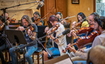 The violins and violas perform on <em>House of Cards</em>