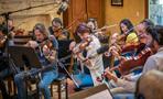 The violins and violas perform on <em>House of Cards</em>