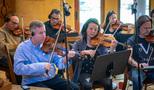 Concertmaster Mark Robertson leads the strings on <em>House of Cards</em>