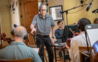 Composer Jeff Beal cues the cellos